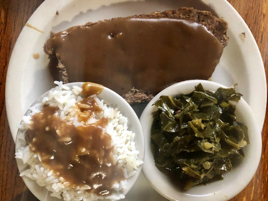 Meatloaf ($11.95) from Farmers Market Restaurant in Fort Myers comes with three sides, in this case rice and gravy, collards and a salad (not shown).