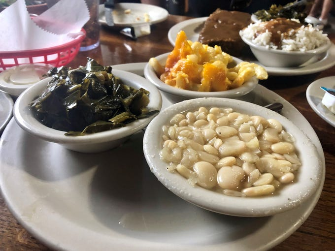 Farmers Market's sides are one of the many things that make this place so wonderful. Collard greens, macaroni and cheese, and white lima beans are shown here.