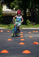 Wesley Pfrommer, 7, of Fort Myers, practices a bicycle obstacle course as part of the Wheel Lee Fun Summer Youth Program.