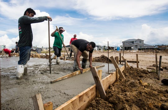 Work progresses on houses at the town of Babcock Ranch on Tuesday August, 6, 2019.