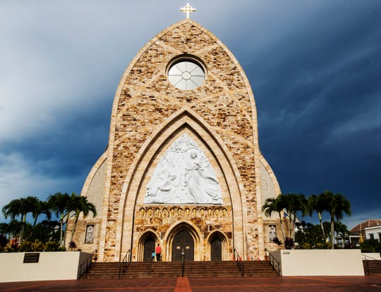 Visitors enter the oratory in the town of Ave Maria on Wednesday August 7, 2019.