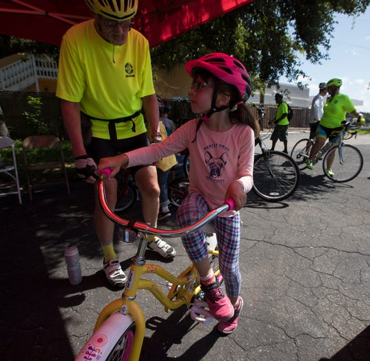 Darbylee Kreider, 5, of Fort Myers, learned how to ride a bicycle as part of the Wheel Lee Fun Summer Youth Program. The program aims to promote bicycle education and safety.