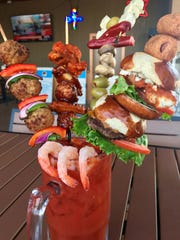 The Ultimate Bloody Mary at Anduzzi's Sports Club in Ashwaubenon is enough for two, or maybe the whole table.