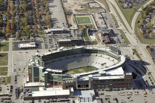 An aerial view of Lambeau Field and the Green Bay Packers' Titletown District looking west. USA TODAY NETWORK-Wisconsin