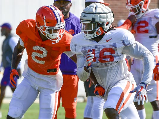 Clemson linebacker John Boyd (46) runs near wide receiver Frank Ladson, Jr. (2) during practice at the Allen N. Reeves Football Complex in Clemson Thursday, August 8, 2019.