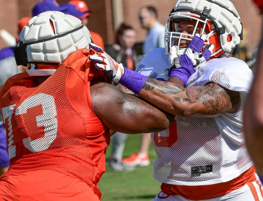 Clemson offensive lineman Tremayne Anchrum (73) and Clemson defensive lineman Xavier Thomas (3) during practice at the Allen N. Reeves Football Complex in Clemson Thursday, August 8, 2019.