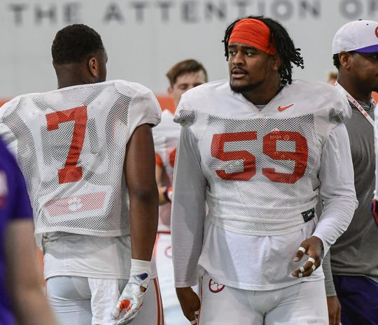 Clemson defensive end Justin Mascoll(7) walks near Clemson defensive lineman Jordan Williams (59) during practice at the Allen N. Reeves Football Complex in Clemson Thursday, August 8, 2019.