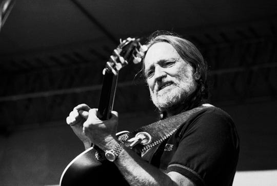 Willie Nelson performs one song during Merle Haggard's set at the 1983 Willie Nelson July 4th Picnic in the infield of Atlanta International Raceway in Hampton, Ga, July 4, 1983.