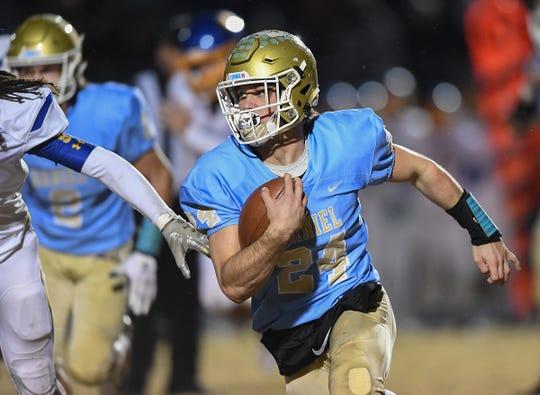 Daniel quarterback Tyler Venables (24)