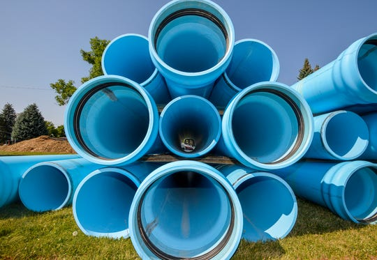 Sections of water pipe being staged in Meadlow Lark Park along Fox Farm Road for a major city water project that will cross under both the Missouri and Sun Rivers.