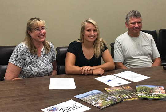 Former Great Falls High star Erin Hocker, flanked by parents Annette and Michael, signed a letter-of-intent to attend Division I DePaul University Wednesday.