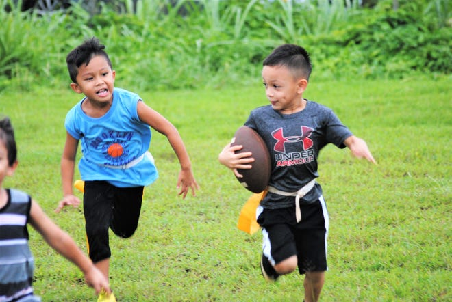 No pads or helmets for the GNYFF's youngest division, Mandikiki flag, Here's a Mandikiki moment from the Tamuning Steelers practice Aug. 7 at the Tamuning field.