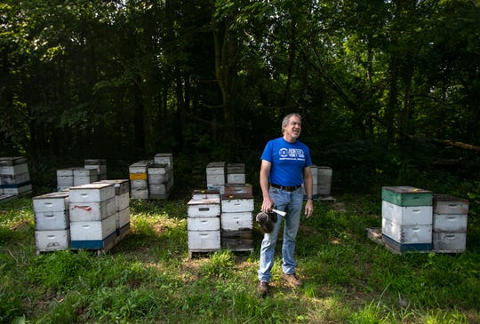 Tracy Hunter stands next to bee hives at Hunter's Honey Farm, Tuesday, August 6, 2019, in Martinsville, IN. The farm has been in the family for the past 109 years and are active in the Indiana Grown community at the Indiana State Fair.