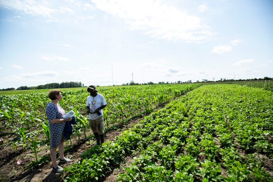 U.S. Sen. Amy Klobuchar, D-Minn., meets with Alfred Matiyabo, of Coralville, Thursday, Aug. 8, 2019, while visiting Grow: Johnson County, off of Melrose Avenue in Iowa City, Iowa. Matiyabo's business Moving 4Ward LLC is in its second year of operation.