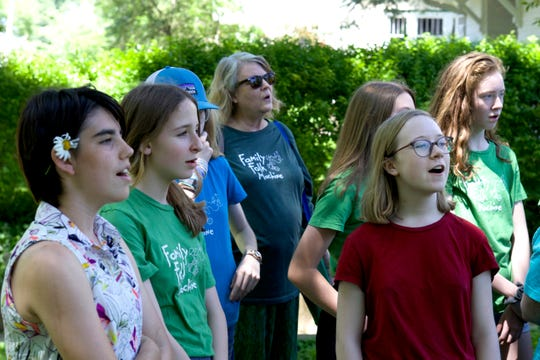 Young singers perform with the Family Folk Machine, Iowa City's intergenerational, non-auditioned community choir.