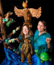"Stephanie Vallez (left) and Monica Leo are surrounded by puppet animals who star in ""The Big Election,"" a timely and creative family show which has scheduled several free Iowa City performances in the coming weeks."