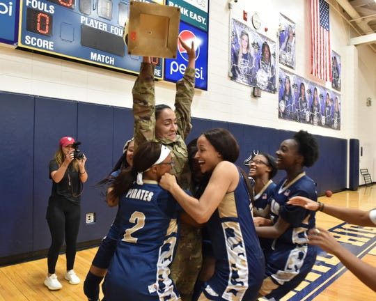 The Pearl High School ladies' basketball team got a surprise start to their school year as coach Lacey Kennedy walked into practice Thursday, Aug. 8, 2019, following a lengthy deployment to the Middle East with the U.S. Army Reserve.