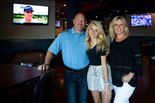 Owners of the Admiral Pub Andy and Whitney Fox and daughter Emma on opening night, Wednesday, Aug. 7, 2019. The Foxes opened the Admiral Pub in the location of The Casual Pint, which closed the previous week.
