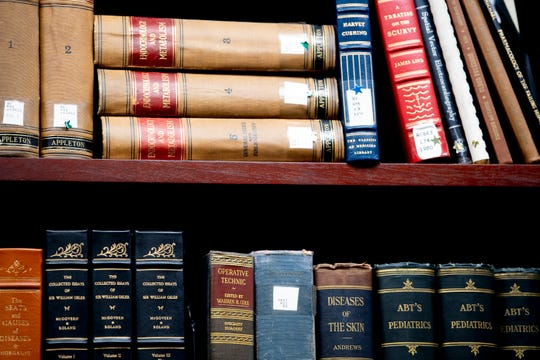 Old medical books sit on a shelf in the Health Information Center at UT Medical Center in Knoxville, Tennessee on Thursday, August 8, 2019.