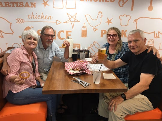 The first-ever customers at the Archers BBQ East location are pals Margie and Wes Priestley, and Pat and Jim Holder. All live in East Knoxville. Aug. 3, 2019.