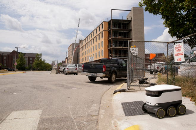A Starship Technologies robot pauses before crossing First st., Thursday, Aug. 8, 2019 in West Lafayette. The self-driving delivery robot is mapping the Purdue campus according to an employee.