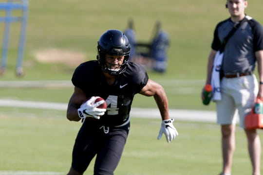 Purdue wide receiver Rondale Moore (4) carries the ball during practice, Thursday, Aug. 8, 2019 at Bimel Practice Complex in West Lafayette.
