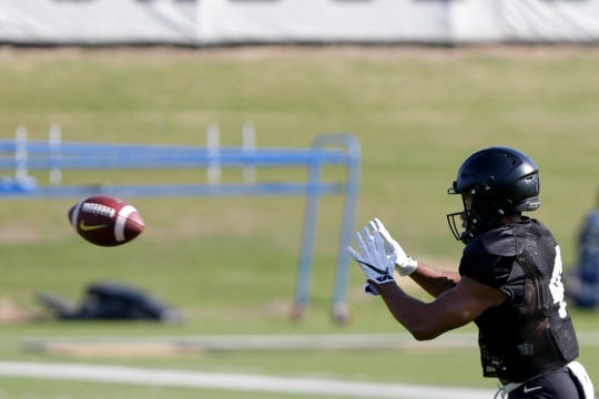 Purdue wide receiver Rondale Moore (4) waits to catch a pass during practice, Thursday, Aug. 8, 2019 at Bimel Practice Complex in West Lafayette.