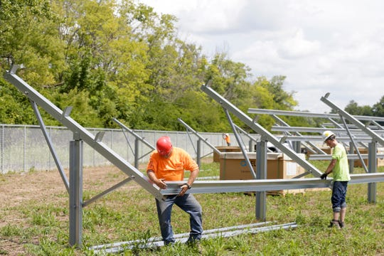 Paul Rich III, left, and Damian High assemble solar panel post in a field along U.S. 231 in Purdue's Discovery Park district between State st. and Airport road, Thursday, Aug. 8, 2019 in West Lafayette. The 10-acre plot owned by Purdue Research Foundation will become a 1.6 megawatt solar power plant for Duke Energy.