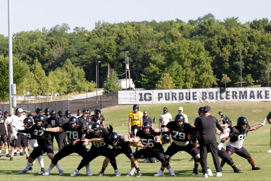 The offensive line blocks during a field goal during practice, Thursday, Aug. 8, 2019 at Bimel Practice Complex in West Lafayette.