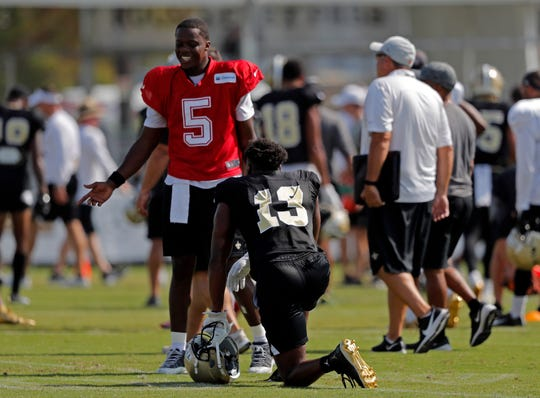 New Orleans Saints quarterback Teddy Bridgewater (5)  talks with wide receiver Michael Thomas (13) during training camp Aug. 1 at their NFL football training facility in Metairie.