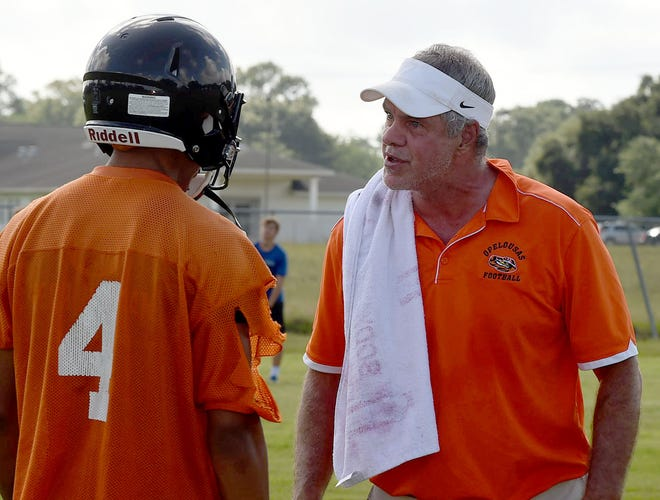 Opelousas High head football coach Doug Guillory (right) explains an issue during the Tigers' 7-on-7 competition with St. Edmund this summer.