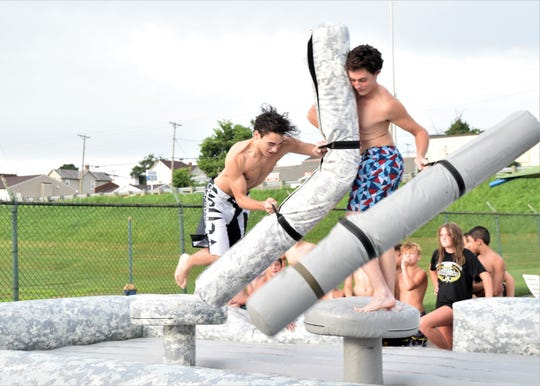 Teenagers compete at the Ohio Army National Guard display during the Teen Night hosted at Miller Pool in Lancaster. The Fairfield County Sheriff's Office worked with the Lancaster Parks Department to have a free night of fun for local teenagers.