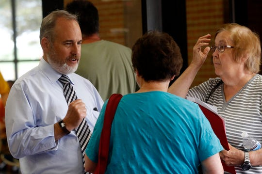 Fairfield County Auditor Jon Slater Jr., left, talks to Nelda Johnson, center, and Sally Malaret, right, both from Pickerington, before they meet with assessors during an informal hearing about their property taxes Wednesday evening, Aug. 7, 2019, at Millersport Junior/Senior High School in Millersport. The auditor's office is holding six meetings during August throughout the county to give property owners the opportunity to give property owners the opportunity to talk to assessors and submit evidence to dispute their newly appraised property values.