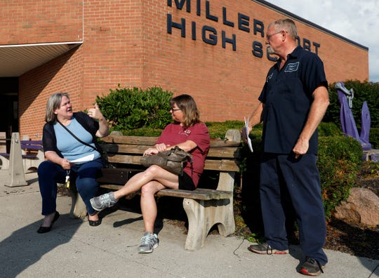 Donna Ruark, left, talks to Tyla Marcum and Paul D. Marcum about the type of evidence she used to try to get the assessed value of her property lowered Wednesday, Aug. 7, 2019, at Fairfield County Auditor's Office informal assessment hearing at Millersport Junior/Senior High School in Millersport. More than 100 people came to the meeting to talk to assessors about the new assessed value of their property. The auditor's office has set three more community meetings throughout the county during August.