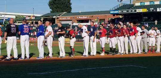 The Louisville Stars standing for the Star Spangled Banner before an Aug. 7 game against the Hattiesburg Black Sox