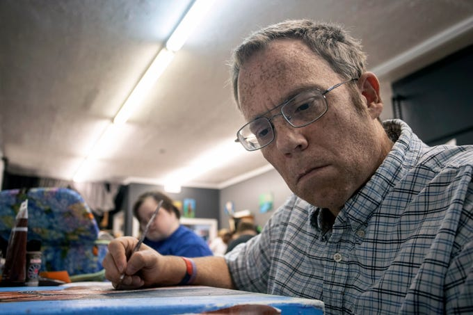 Mike Donnelly works on a painting of a horse from an actual photo on a Tuesday afternoon at Creative Diversity Studio on Barret Avenue. 8/6/19