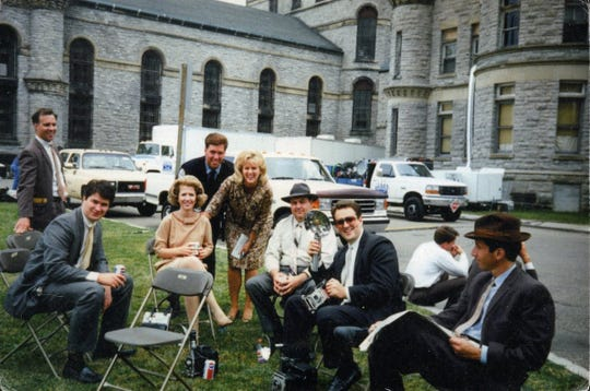 "Mansfield residents serving as extras  take a break in filming in ""The Shawshank Redemption,"" including News Journal reporter Lou Whitmire, standing in the center."
