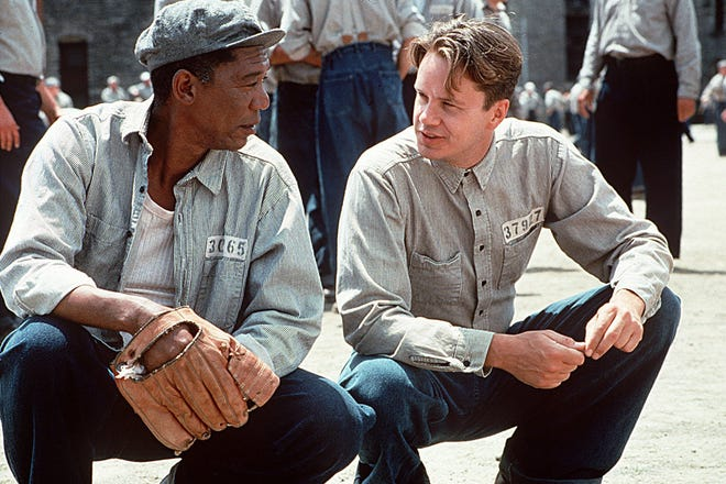 "Morgan Freeman, left, and Tim Robbins starred in the film ""The Shawshank Redemption.""  Steve Oster, the superintendent for the Board of Developmental Disabilities for Coshocton and Knox counties, met Freeman while playing an extra in the film that's marking its 25th anniversary."