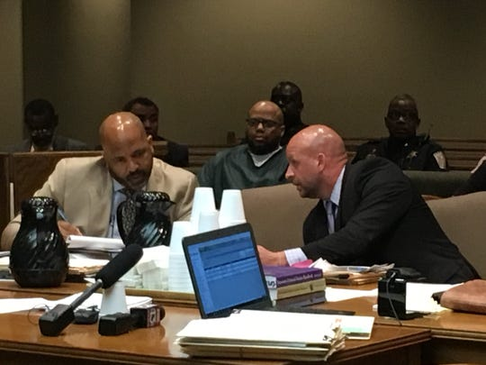 Prosecutor Paul Hagerman (right) speaks with defense attorney John Keith Perry as Billy Turner (center) sits behind them during an August 8, 2019 hearing.