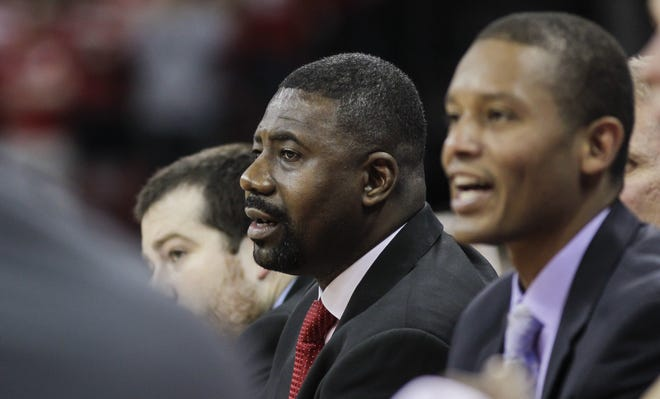 UW assistant Howard Moore was seriously injured in a automobile crash in May.