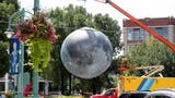 A 23-foot replica of the Earth's moon was raised above Catalano Square in the Historic Third Ward for the Under One Moon pop-up festival Aug. 9 to 11.