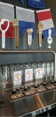 The bar at Fork & Tap in Port Washington uses a system that fills the glass from the bottom up.