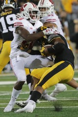 Wisconsin cornerback Faion Hicks  brings down Iowa running back Ivory Kelly-Martin in the Badgers' victory last season.