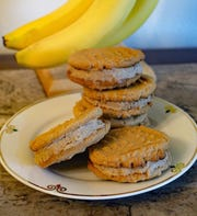 Caramelized bananas are mashed into the filling in these winning peanut butter sandwich cookies.