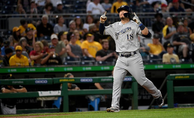 The Brewers' Keston Hiura rounds third on his home run in the fifth inning.