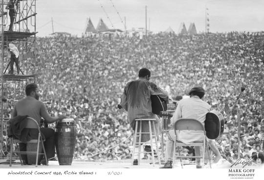 This August 1969 photo shows Richie Havens as he performs during Woodstock in Bethel, New York. The photo is only one of hundreds made by photographer Mark Goff who, at the time, worked for an underground newspaper in Milwaukee. Some were published, but the negatives were filed away at his Milwaukee home and barely mentioned as Goff raised two daughters, changed careers and, last November, died of cancer. Dozens of Goff's Woodstock shots are being displayed 50 years later.