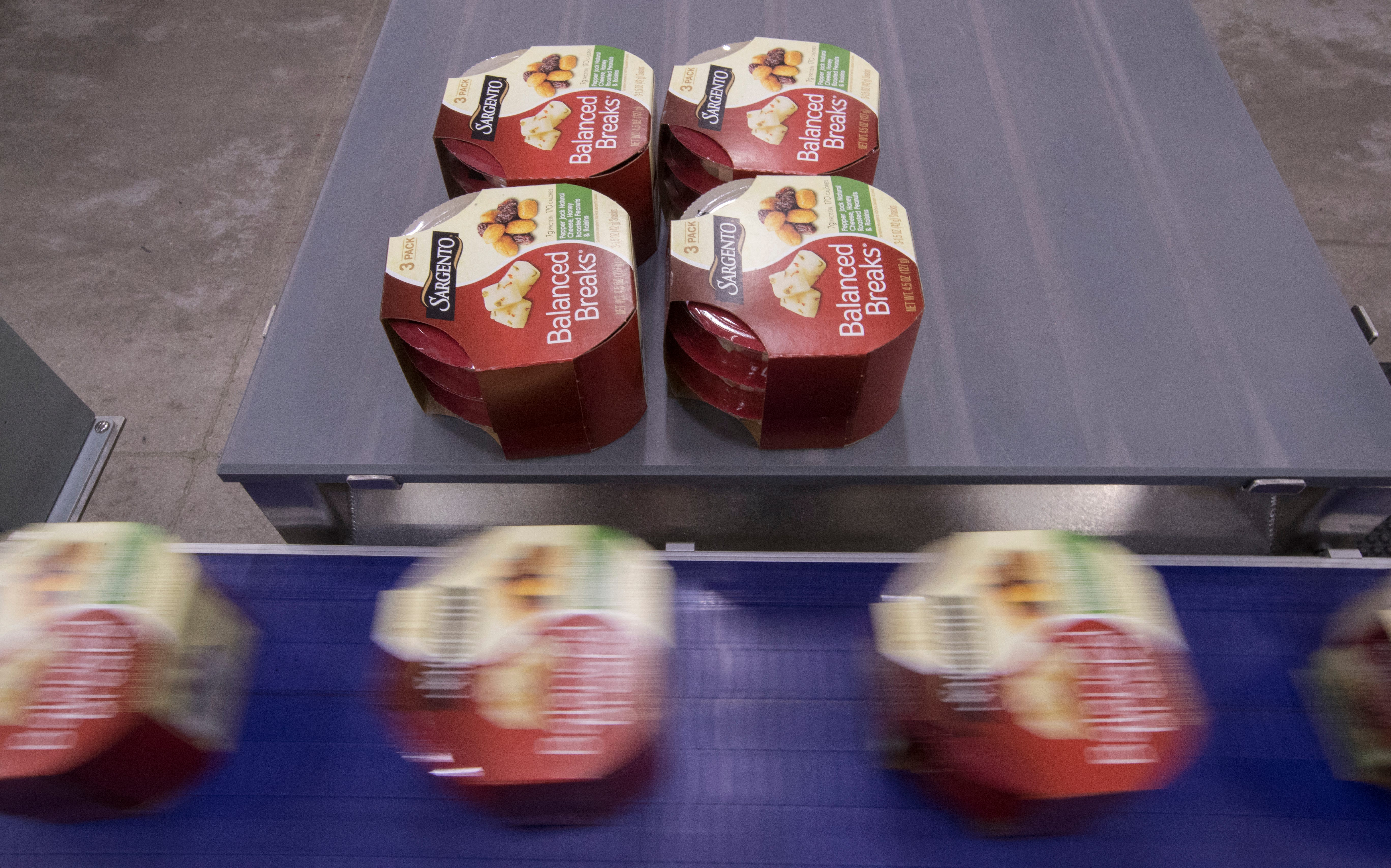 Packages of Balanced Breaks snacks move through for packaging at Sargento Foods Inc.