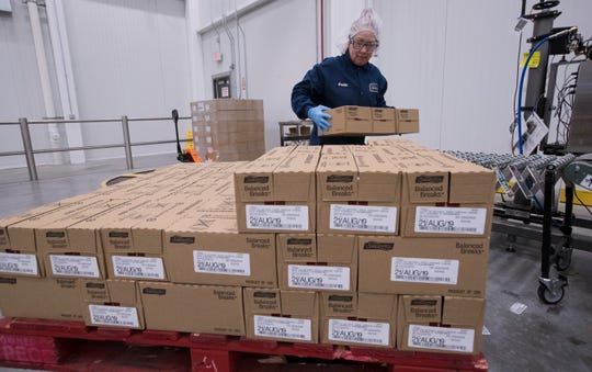 Kristin Geary works on a line packaging Balanced Breaks snacks Sargento Foods Inc.