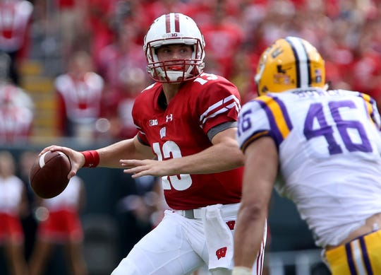 UW quarterback Bart Houston drops back to pass in the first quarter against LSU on Sept. 3, 2016, in Green Bay. Houston threw for 205 yards in the Badgers' 16-14 victory.