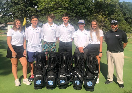 Members of the Cotter High School golf teams pictured with new equipment are: (from left) Anna Haynes, Logan Principato, Hudson Adams, Hayden Hutson, Christian Cloyd, Tylar Coots, and Matt Kemp of Twin Lakes Golf Course.